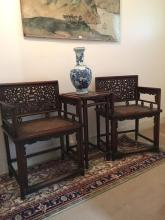 Pair of Chinese Huanghuali rose chairs 'Meiguiyi' with matching tea table, possibly Qing Dynasty, well carved qilong detail to backs of chairs with Shou characters to chairs and table, each chair is 87cm H x 60cm W, table is 72cm H x 33cm W x 42.5cm D