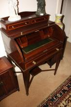 Antique cylinder roll top desk, flame mahogany with inlaid urn detail, multiple drawers, pigeon hole interior with slide-out leather inset writing surface, 69cm W