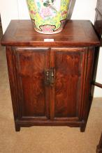 Pair of Huanghuali 'Kang' cabinets 'Yuangaogui' each with a pair of well figured panelled doors, 58cm T x 40cm W