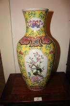 Pair of Chinese vases, each decorated with panels of birds and flowers on a yellow ground with 6 blue character marks to underside, each 41cm T
