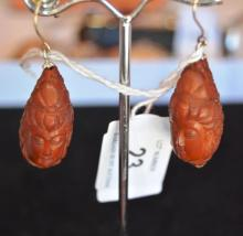 Pair of carved wooden earrings each in the form of a Guanyin head, with 18ct gold sheppards hooks and silver caps