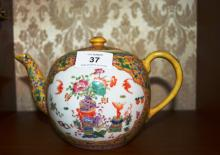 Chinese famille rose teapot, ornately decorated, red character marks to underside