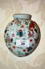 Unusual Chinese porcelain wall vase in the shape of a bag with enamel floral decoration and raised bat detail, blue character marks to rear, 13cm T