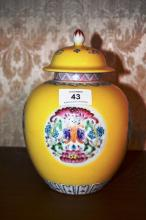 Chinese lidded jar, 4 panels of flowers on a yellow ground, blue character marks to underside, 20cm T