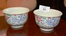 Pair of small Chinese famille rose tea bowls with phoenix decoration, each 6 character marks to underside, 9cm D