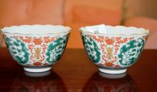 Pair of Chinese famille rose tea bowls, fluted design, dragon detail, blue character marks to underside, 10.5cm D