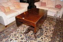 Antique mahogany drop-side centre table, Victorian, single drawer, central stepped column with nicely shaped base with 4 outswept legs with brass paw feet & castors, 91cm L
