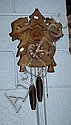 Black forest style cuckoo clock with carved wooden