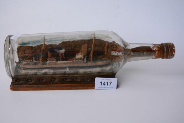 Early hand made model ship in a bottle,