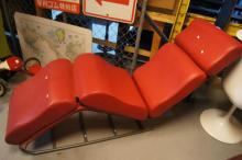 Red vinyl upholstered chaise lounge,
