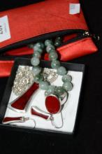 Necklace, earring and ring set with red stone,