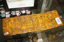 Carved double sided panel with scenes of