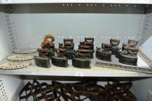 Shelf: metal name plaques,