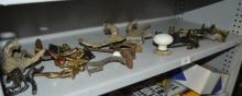 Collection of antique brass hat & coat hooks,