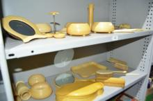2 shelves of early xylonite dressing table items,