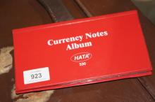 Currency notes album with various notes