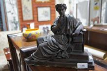 Cast bronze figure of a reclining