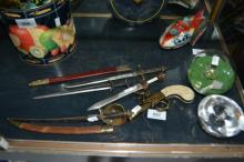 Collection of miniature sword letter openers,