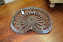 Antique cast iron tractor seat, made by H.V. McKay