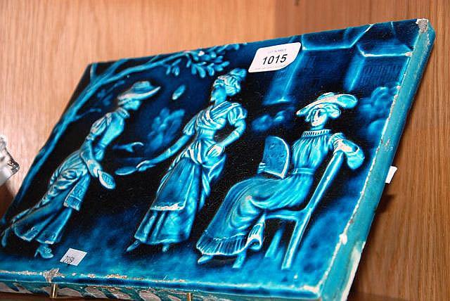 Antique tile plaque with raised design of 3 ladies