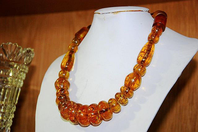 A distressed Amber resin beaded necklace