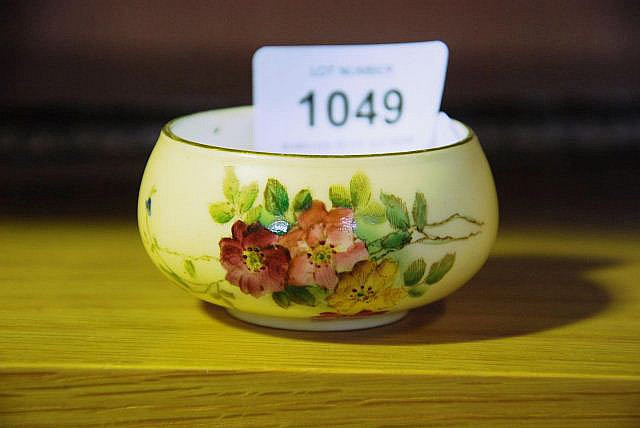 A small Royal Worcester pot, hand painted floral