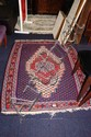 A vintage tribal flat-weave woollen hand-woven rug