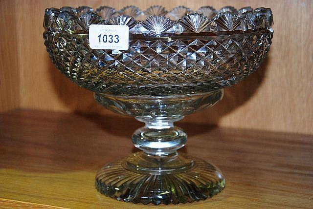 An antique cut crystal fruit bowl with turned