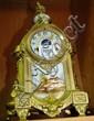 An antique French mantel clock, gilt spelter case