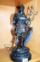 An antique Spelter figure of a Viking with a robe,