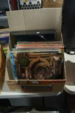 Box containing LP records and a record player