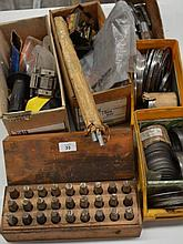 A set of number punches, a large collection of