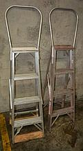 A pair of Welbilt industrial aluminium ladders