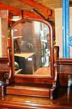 Antique cedar toilet mirror, arched shape on a platform base with hinged jewellery storage drawer, 53cm W x 73cm T