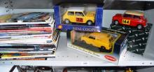 3 various large scale die-cast Mini Cooper's - all with boxes and a bundle of Mini related car magazines etc