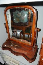 Cedar toilet mirror, arched shape with a serpentine shaped platform base, needs repolish to base