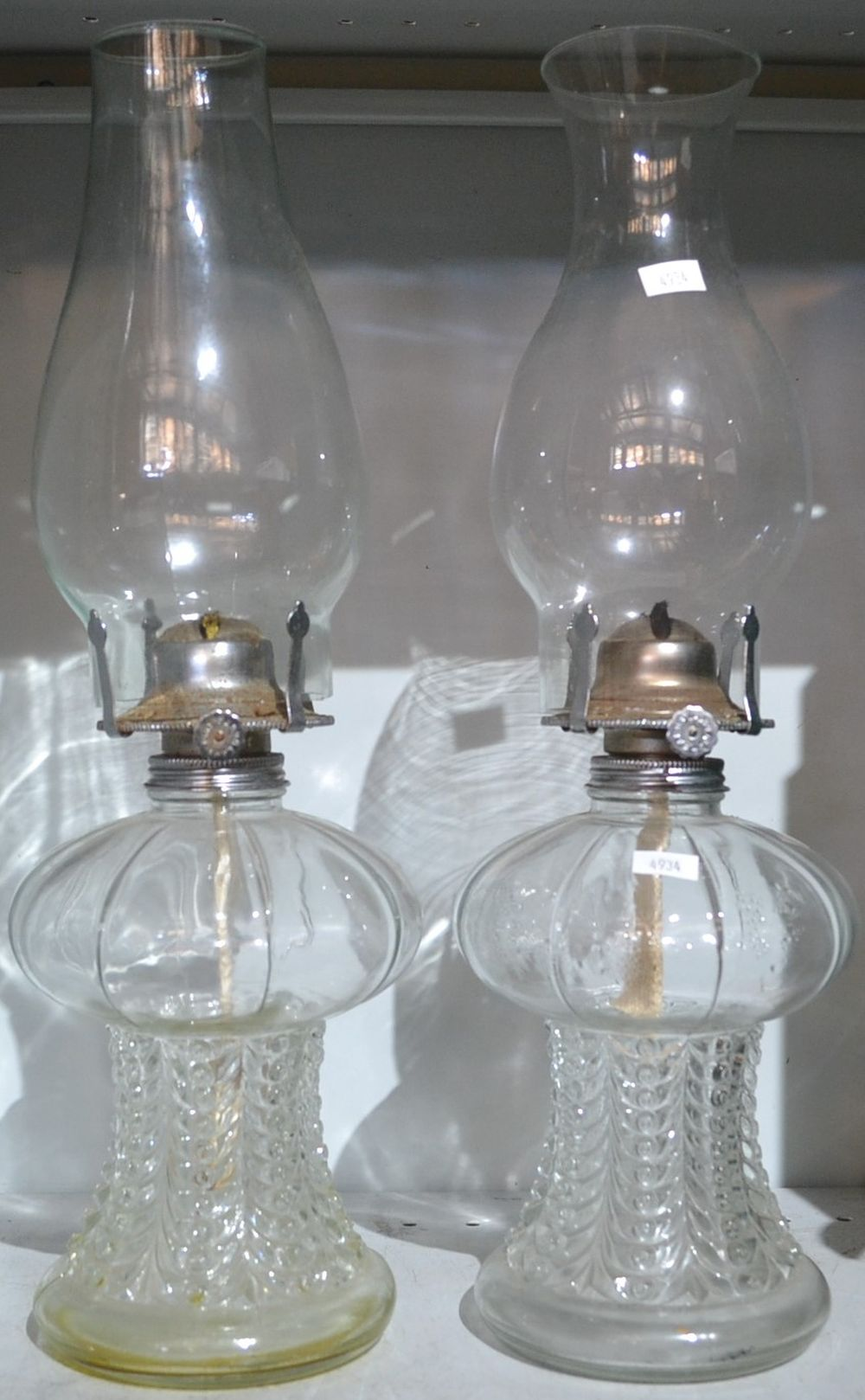 A pair of glass oil lamps,