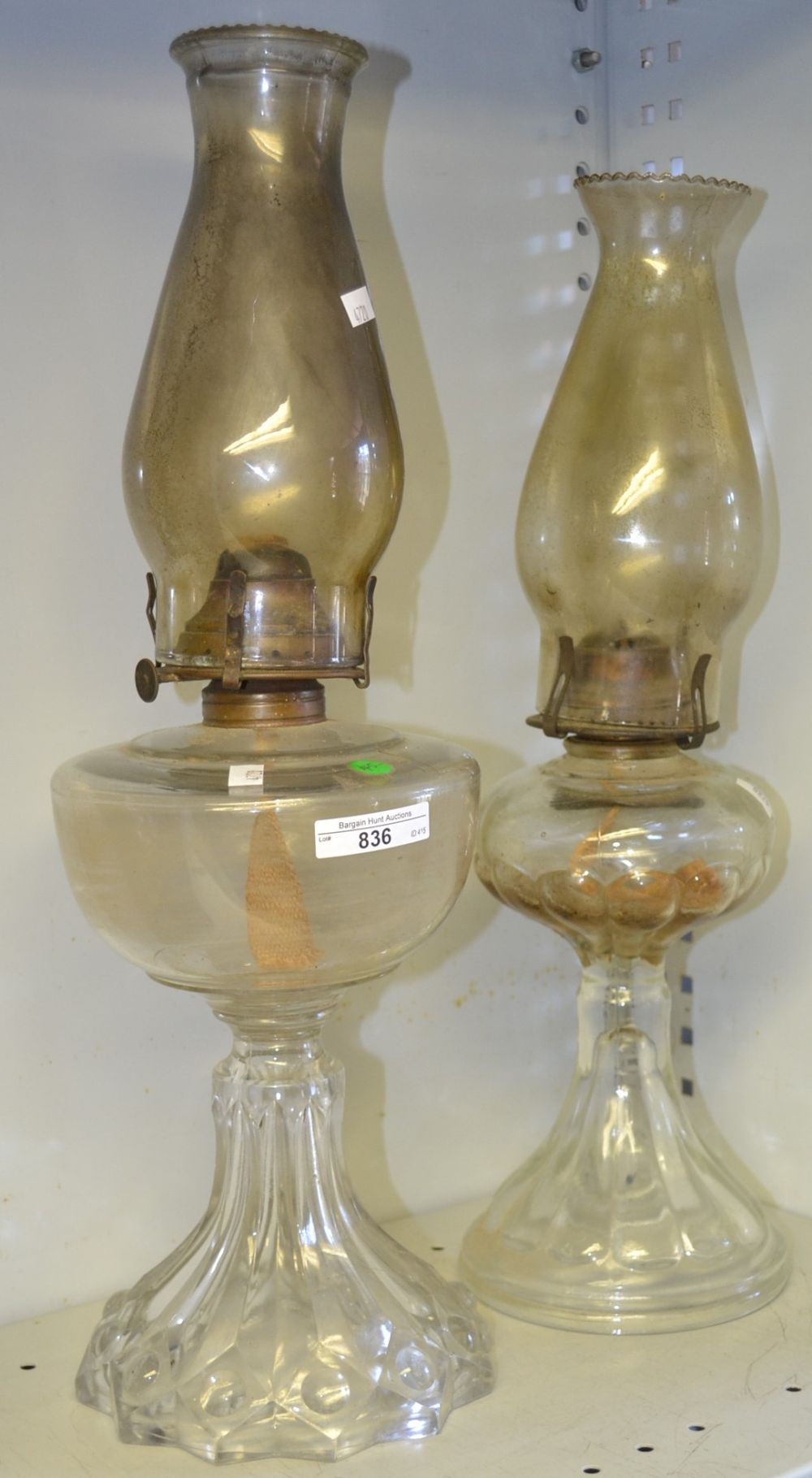2 assorted glass oil lamps with flues,