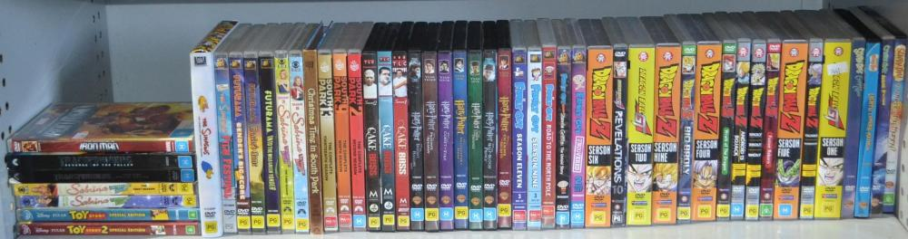 Shelf of assorted DVDs to incl.