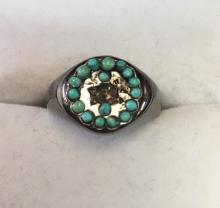 Sterling silver oxidised Turquoise and diamond signet ring. Set with a central rough cut diamond boarded by multiple turquoise. Ring size: L
