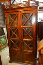 Empire style teak bookcase with a pair of glazed doors with internal adjustable shelving, flanked by ebonised columns, no key, 199cm T x 104cm W