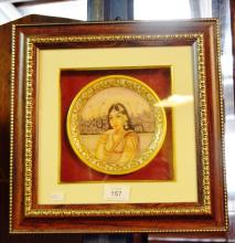 Hand painted alabaster Indian portrait plaque of a maiden with gilt highlights, box frameed, plaque is 15cm D