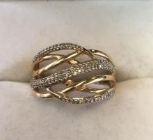 10kt yellow gold diamond set dress ring. Set with multiple brilliant cut diamonds in a claw mount. Ring size: O1/2
