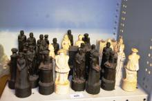 Qty of carved resin chess pieces, English Tudor theme