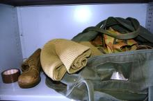 Qty of army uniforms incl. boots, jackets, jumper, etc
