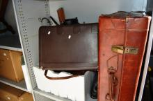 Shelf: vintage suitcases, tools, artists easel and a glass tulip