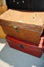 2 tin trunks and brown suitcase