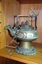 An Asian brass teapot with pierced & engraved