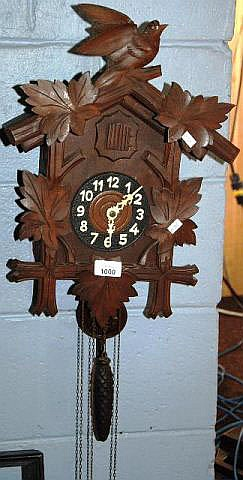 A vintage black forest cuckoo clock