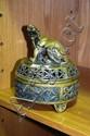 A cast bronze lidded incense burner, pierced